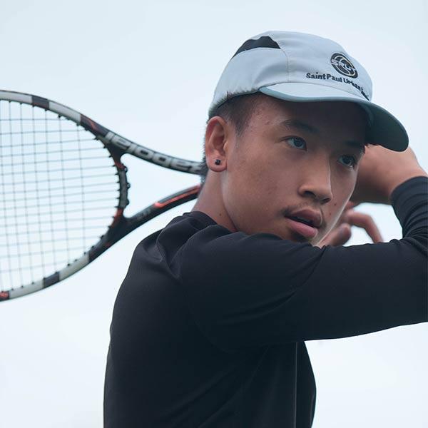 boy-playing-tennis